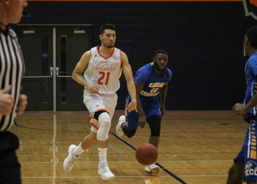 Sophomore Jesus Izquierdo drives the ball down the court against KCC.