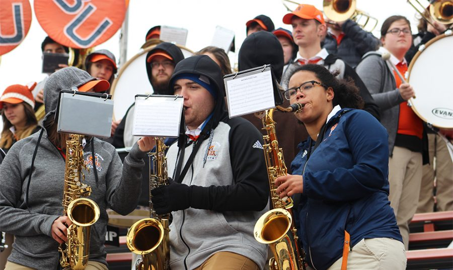 Senior Amanda Love and other band students play the saxophone. The band performed at Liston Stadium while the Wildcats took on Georgetown. They played a number of different songs throughout the game.