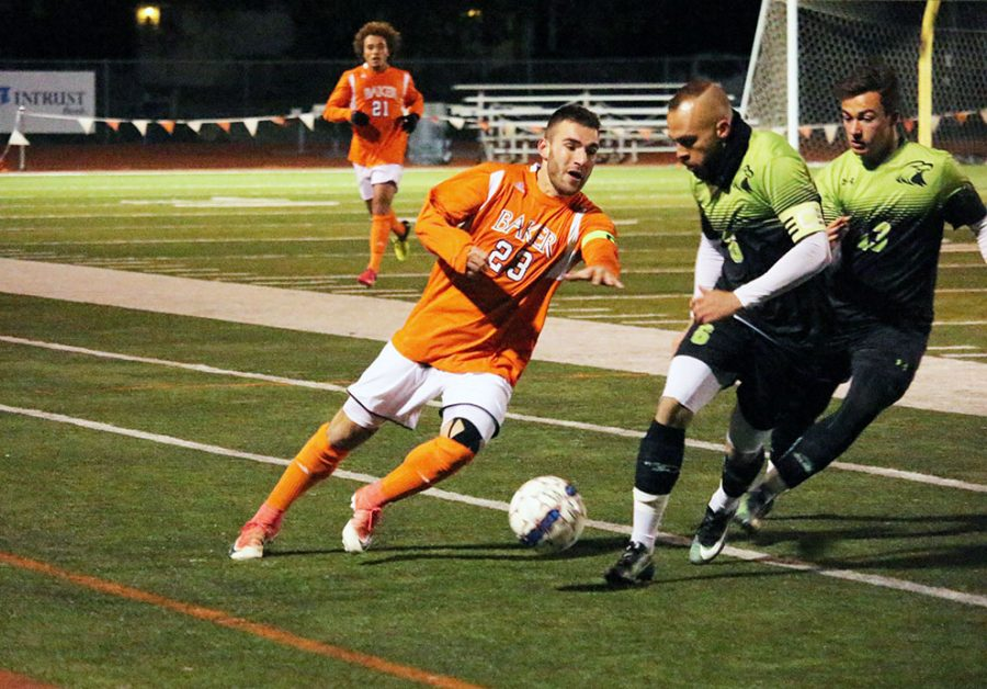 First Team All-Conference member Blake Levine maneuvers the ball down the field against CMU. Levine had the only goal of the game in the 33rd minute.