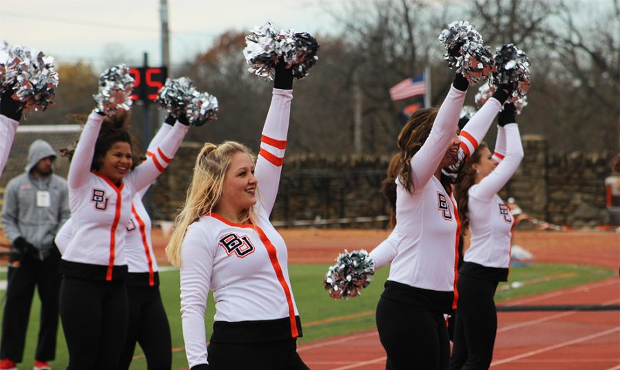 Senior Krista Porter pumps up the crowd who eagerly await the Nov. 18 game to begin at Liston Stadium. The dance team performed during halftime.