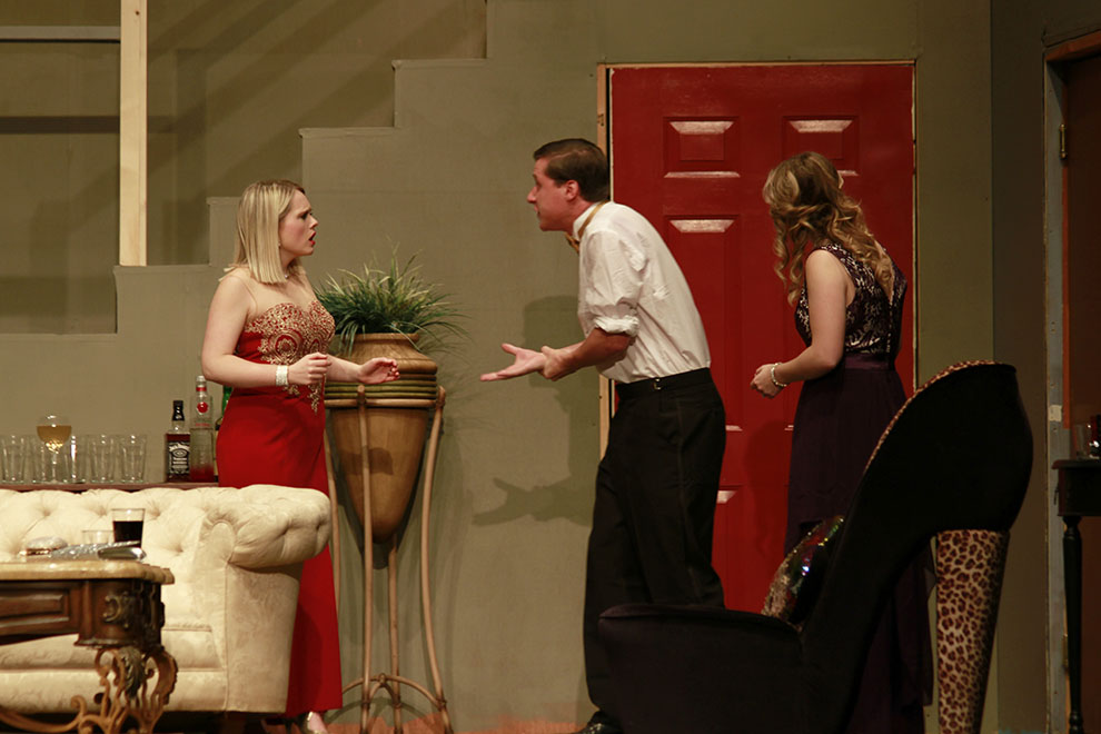 """""""Rumors"""" opened Thursday in the recently renovated Rice Auditorium. Senior Haley Roberts, junior Jason Shipps, and sophomore Erynne Jamison are pictured above."""