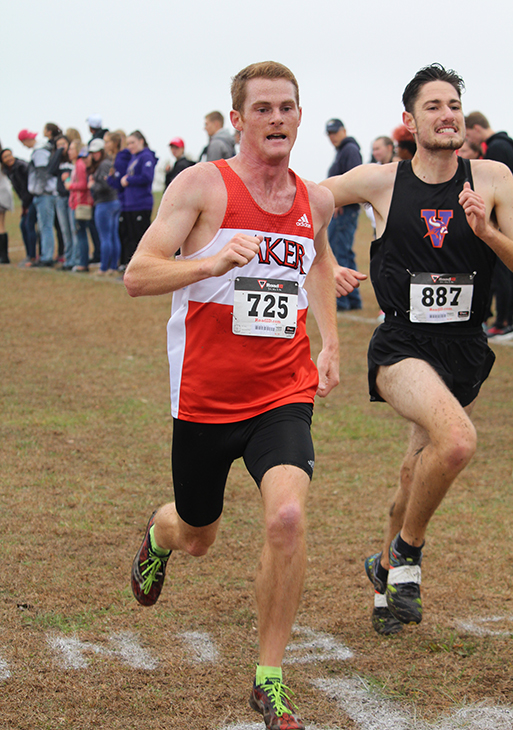 Senior Joe Linder pushes towards the finish line at the Heart Conference meet on Nov. 4. Linder placed 13th overall and was the final individual qualifier for the national meet. Teammates Greg Flores and Liam Barnsby also qualified for the national meet in Vancouver, Washington.