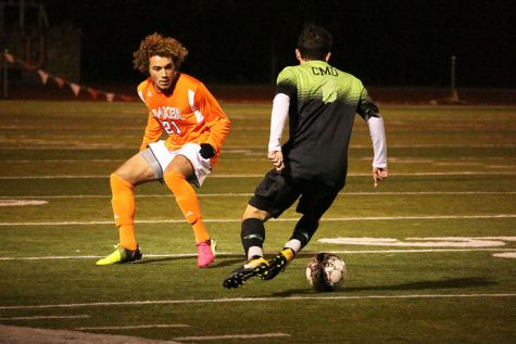 Men's soccer earns first win