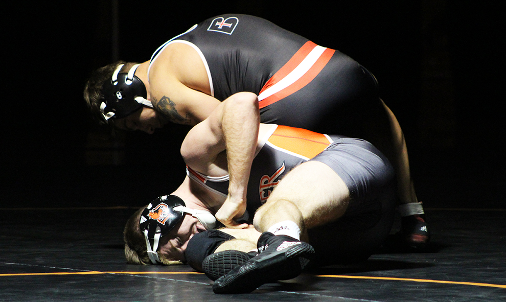 Baker's Colby Johnson takes on Benedictine's Austin Roper in the 149-pound match up. Baker defeated Benedictine with a score of 34-19.