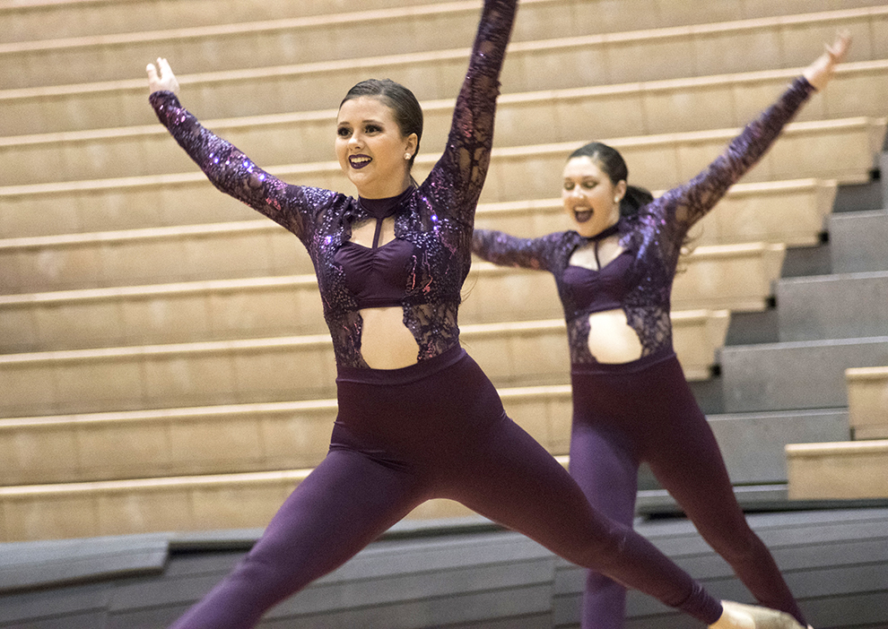 Freshman Gracie Chambers leaps across the floor during the dance team's routine on Jan. 28. The team's first place performance was choreographed to Lady Gaga's