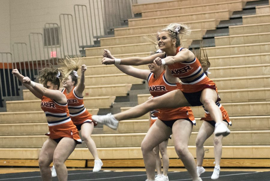 Freshman Sierra Ballinger hits a jump during the cheer teams routine. The cheer team also hosted a triangular with MidAmerica and Graceland where they placed second.