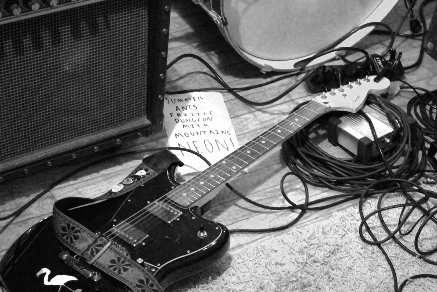 Freshman Tre Byers' guitar next to the night's set list. Byers and his band Dodging played a 30 minute set at a house show in Lawrence on Feb. 3.