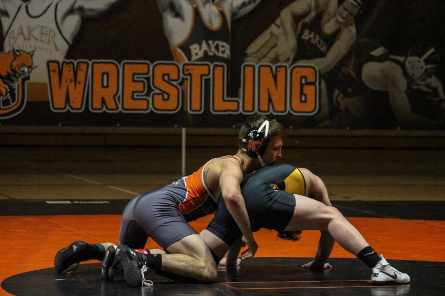 Tyler+Dickman%2C+a+junior+in+the+141+pound+weight+class%2C+scores+a+takedown+as+the+Wildcats+take+on+Ottawa+for+Senior+night.