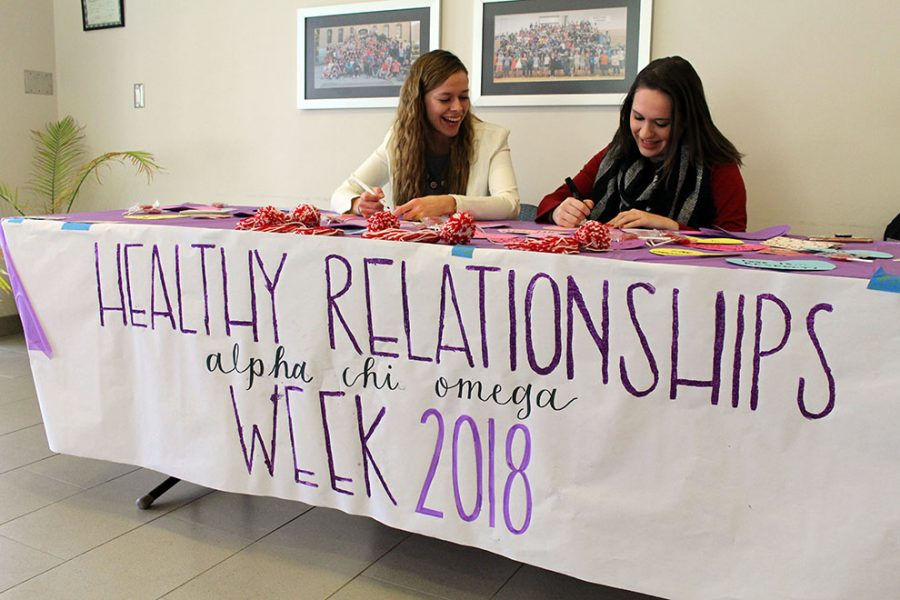 Alpha Chi Omega members Darby Fugitt and Alanna Dierking ask students what love means to them in Harter Union on Feb. 12. The sorority celebrated Healthy Relationships in support of their philanthropy, Domestic Violence Awareness.