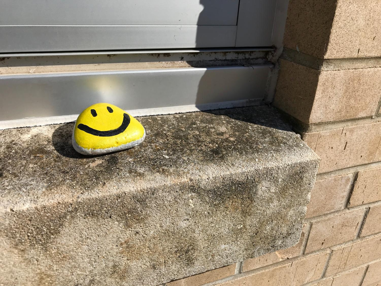 A Smiley Stone sits on a window sill outside the Harter Union.