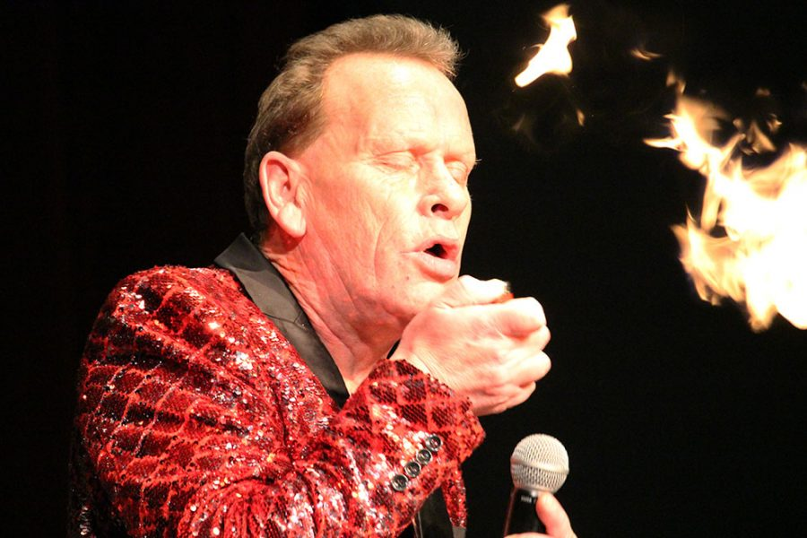 Starr holds a lighter in front of his mouth as he belches out lighter gas to create fire. Starr traveled to America for his shows in Kansas and Connecticut. His goal is to complete 2,000 shows by the end of 2018.