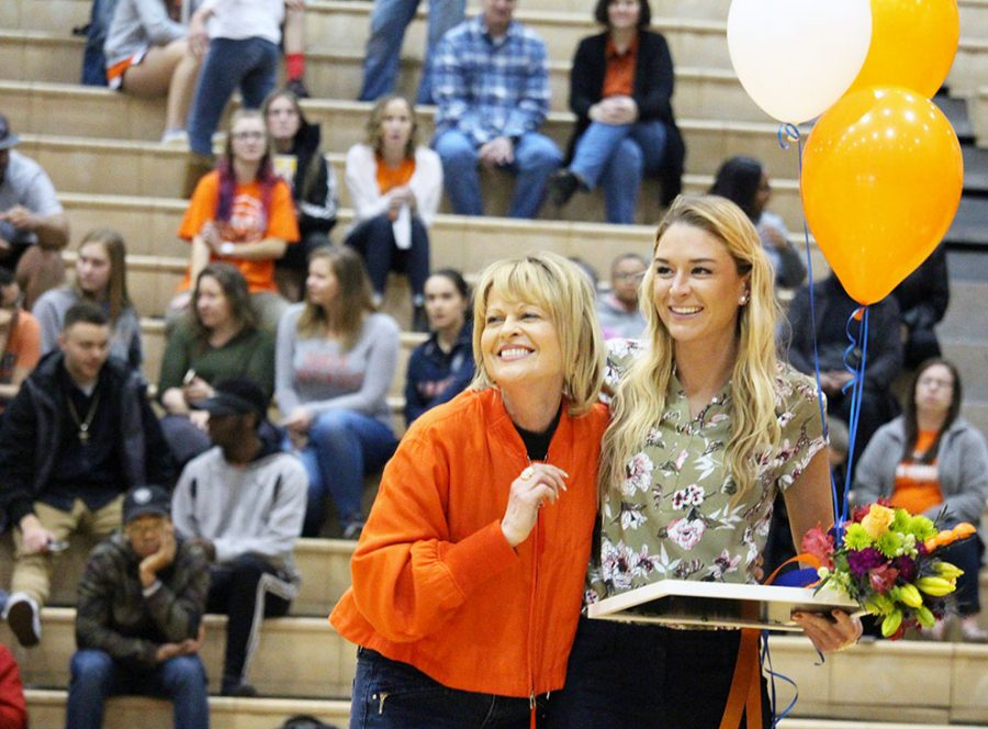 President Lynne Murray and womens graduate assistant coach Jami Hodge gather at half court to recognize the senior basketball players. Each player was recognized with their parents or other guests as career statistics, quotes and memories were announced. The womens senior class is the second-most winning class to play at Baker.