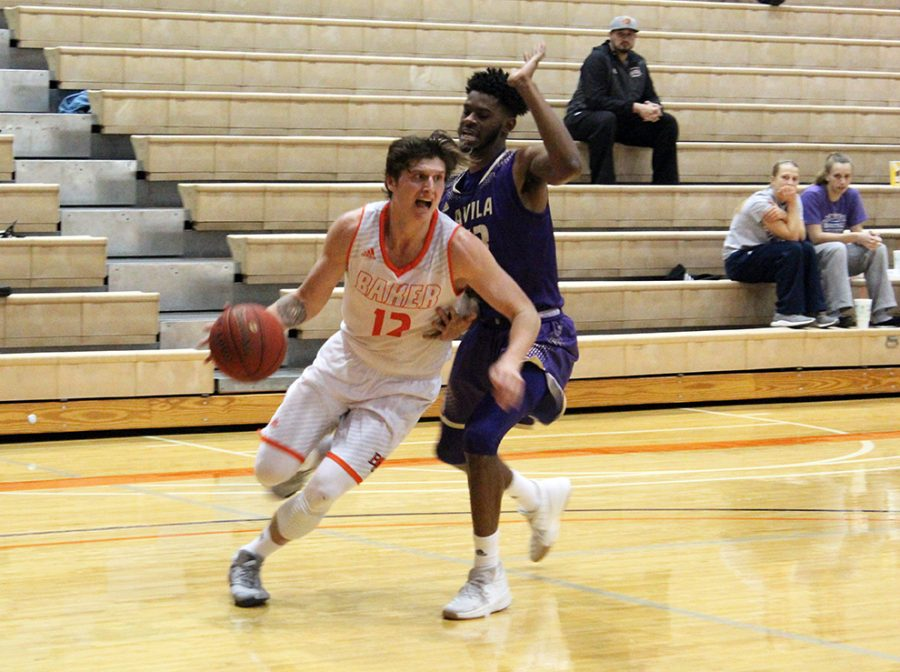 Senior Nate Guscott drives to the basket against an Avila defender inside Collins Center in the teams' earlier matchup. Baker defeated Avila 71-60 on Feb. 17.