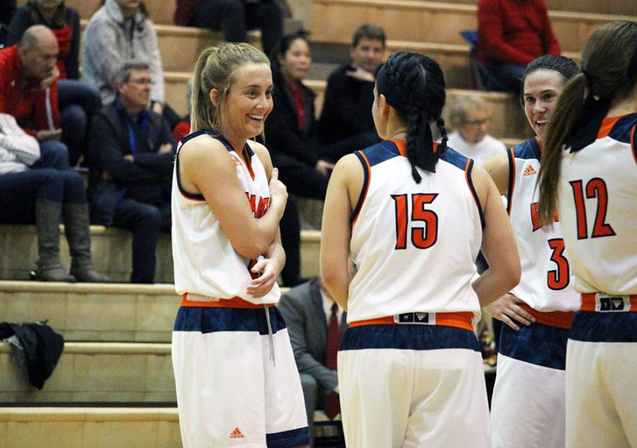 Senior+Sydnie+Hanson+congregates+with+her+teammates+during+a+timeout.+Hanson+along+with+Jo+Lira+and+Courtney+Hoag+played+in+their+last+regular+season+game+inside+the+Collins+Center.+Hanson+was+also+named+a+CoSIDA+Academic+All-District+award+winner.