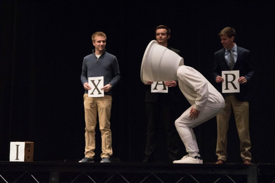 Freshman Liam Barnsby, Zeta Chi's representative, displays his Pixar lamp costume at Mr. BU as his fraternity brothers help set the scene, and then Barnsby proceeded to stomp on the