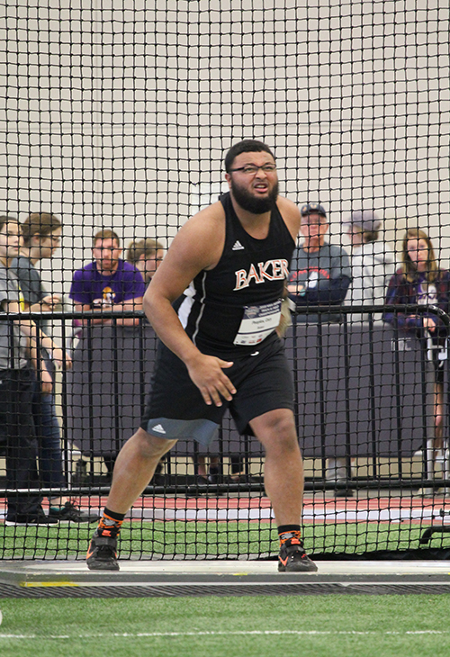 Senior+Cory+Peoples+completes+his+first+throw+of+17.27+meters+in+the+weight+throw+event.+Competitors+in+the+event+throw+three+times.+Peoples+was+unable+to+surpass+his+17.27+on+his+last+two+throws.+