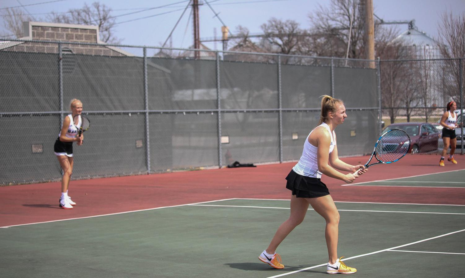 Kayelee Smith and Morgan Francis stand ready as they prepare for a serve in a doubles match against Ottawa University.