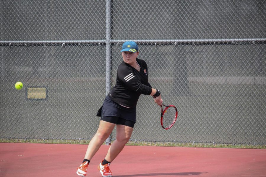 Kate Taylor-Doran prepares to return a serve against Ottawa University.