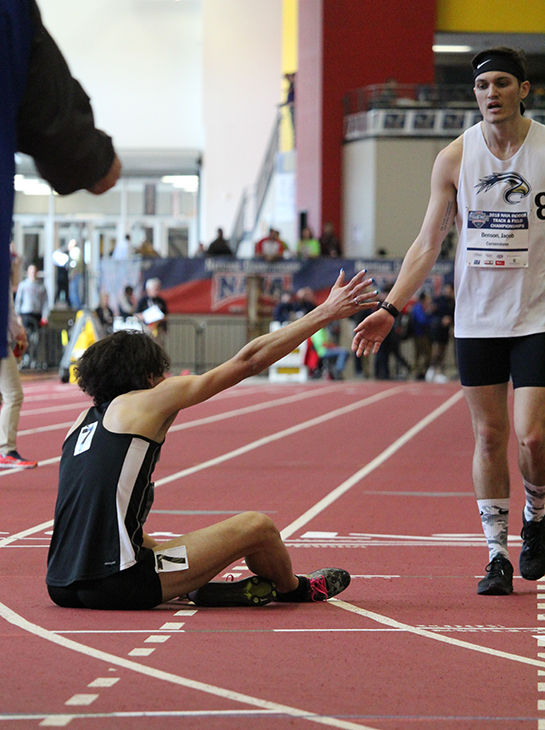Watson high-fives a competitor after collapsing on the ground at the finish-line. Watson finished seventh in the race, but due to the disqualification of another competitor she moved up to sixth place overall, making Watson an All-American. Watson is the first mens racewalker to receive All-Amercian honors.