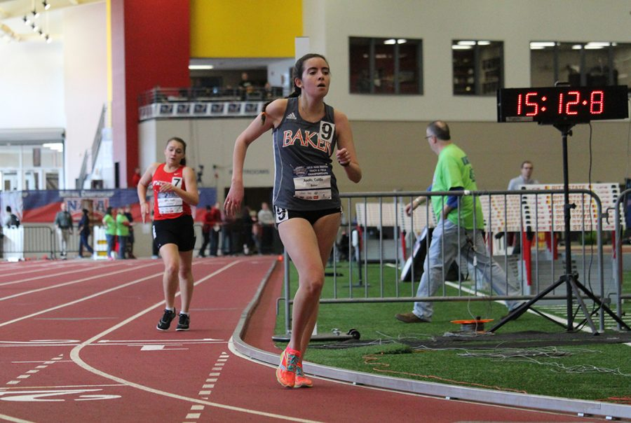 Caitlin Apollo goes into her last lap of the 300-meter race. Race walk is a sport of speed and technique. Competitors must keep one foot on the ground at all times during the race and the knee must be straight when the leg comes down. If a competitor receives three infractions of these rules from the judges placed around the track, they are then disqualified.