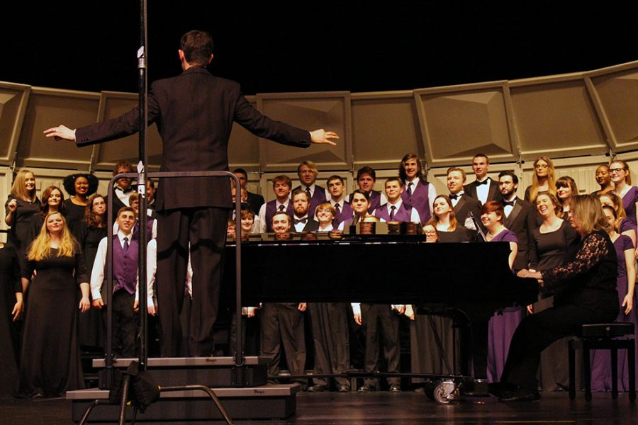 The Baker University choir performs alongside the Baldwin High School Choir inside the Baldwin High School Auditorium on March 6. The two choirs did a combined performance to the song Jabberwocky.