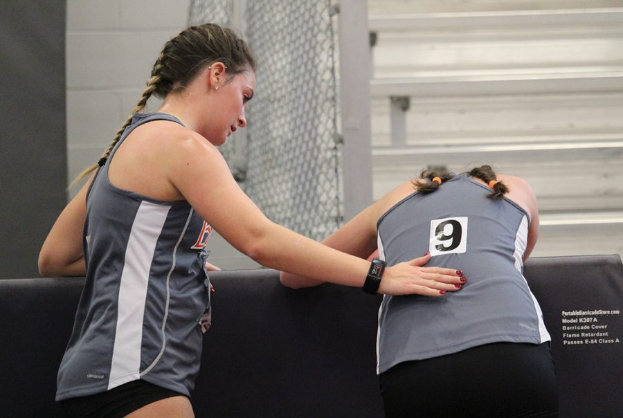 Brenda McCollum comforts Caitlin Apollo after the womens 3,000-meter race walk at the NAIA National meet in Pittsburgh, Kansas on March 4. McCollum and Apollo are a dynamic duo according to their coach Tim Byers. The two hope to qualify for the outdoor national championships in May, making it their last collegiate meet. McCollum hopes to take her race walk careers to the next level after graduation with sights on the United States Olympic team.