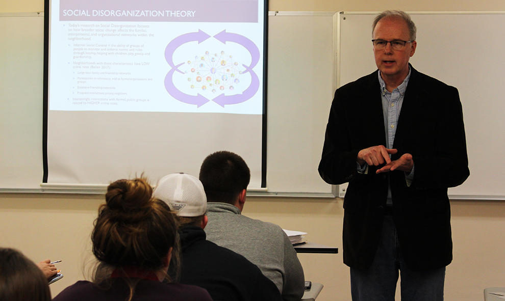 Professor of Sociology Tim Buzzell teaches his criminology class on March 7. The Kansas City Police Department also presented to the class and all who are interested in law enforcement on March 21.