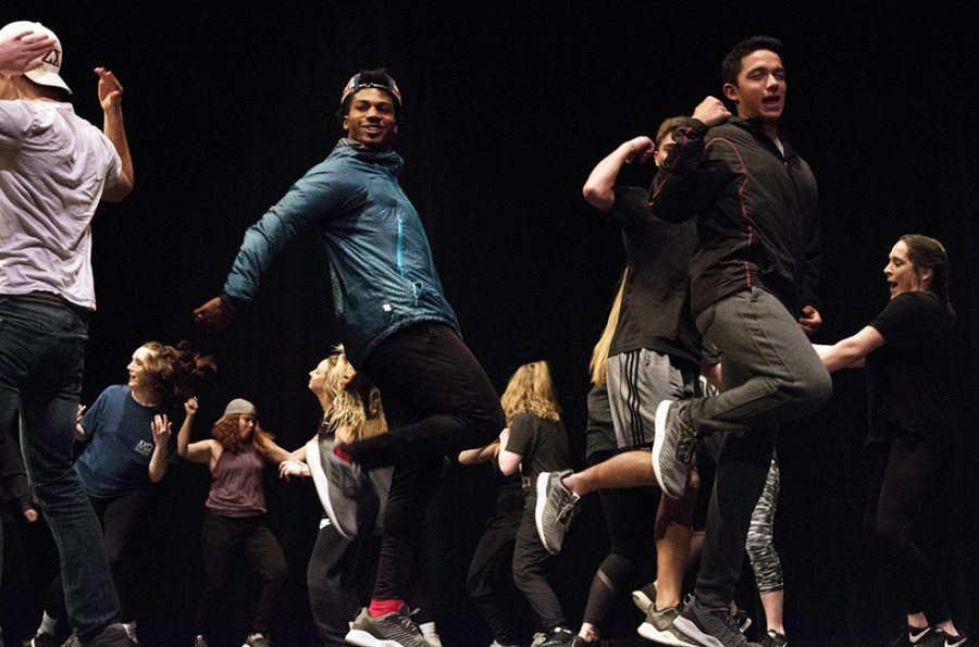 Zeta Chi members Fabian Franck Love and Tyler Winsor dance at the front of the stage in their Greek Sing performance. Zeta Chi and Alpha Chi Omega finished in second at the event.