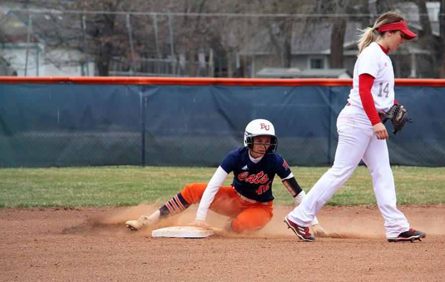 Jazzmine Thorpe slides into second base after hitting a double.