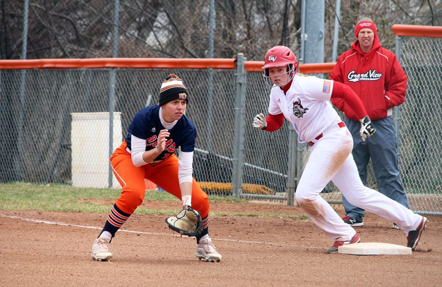 First baseman Rachel Wheeler crouches in preparation for the ball. Wheeler had two hits and one RBI in the second game of the doubleheader.