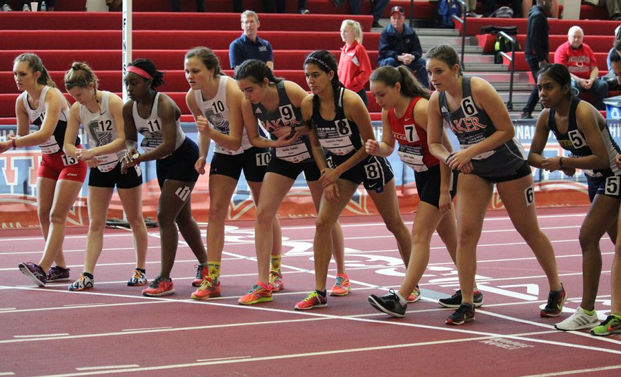 Seniors Caitlin Apollo and Brenda McCollum toe the line before the gun goes off in the womens 3,00 meter race walk on March 3 inside the Robert W. Plaster Center at Pittsburg State University. Competitors hold their watches to set a stopwatch to keep track of their individual times during the race and after they cross the finish. This practice is common in most distance events. the NAIA is the only collegiate athletic division that offers mens and womens racewalk.  The vent has a rich history and is an Olympic event.