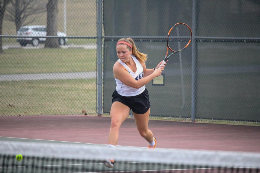 Senior Holly Chestnut lunges for a ball in her match at Ottawa University.