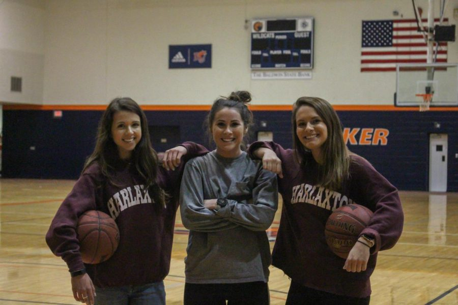 Miranda Lindmark, Brittney Diehm and Rosie Hollis pose as they get ready to host the around the world basketball tournament for studying abroad.