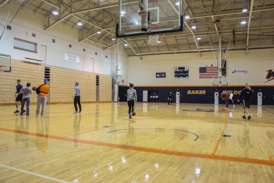 students warm up for the around the world tournament in Collin Gymnasium. Winners earn 25 Dollar Chipotle gift cards.