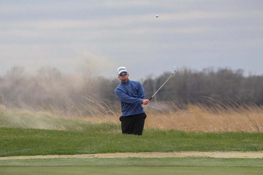 Thomas Taber watches his ball after hitting out of the sand and on to the green.