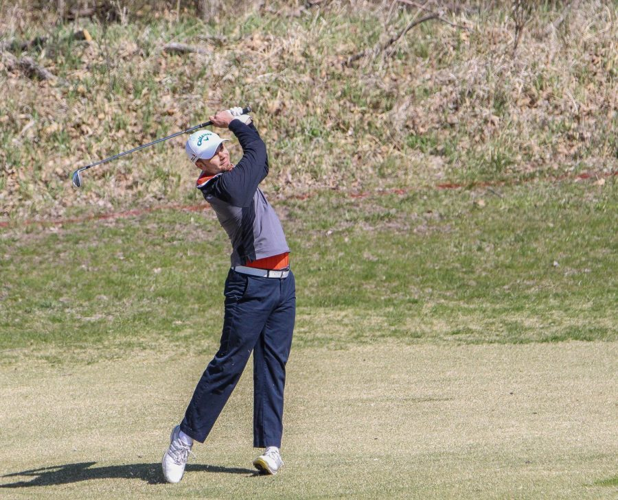 Junior Kyle Barbee watches his approach shot during the annual Baker Spring Invitational.