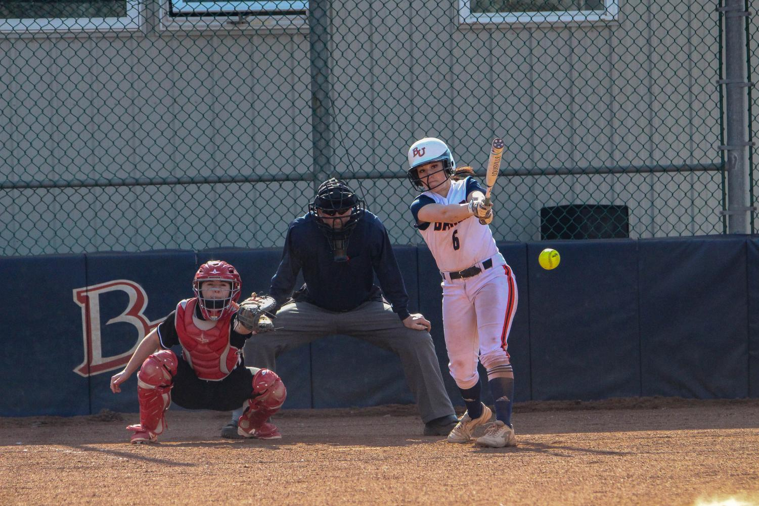 Sophomore Hannah Flynn gets a hit against Benedictine on March 9. Flynn has a .343 batting average this season with two home runs and 17 RBIs.