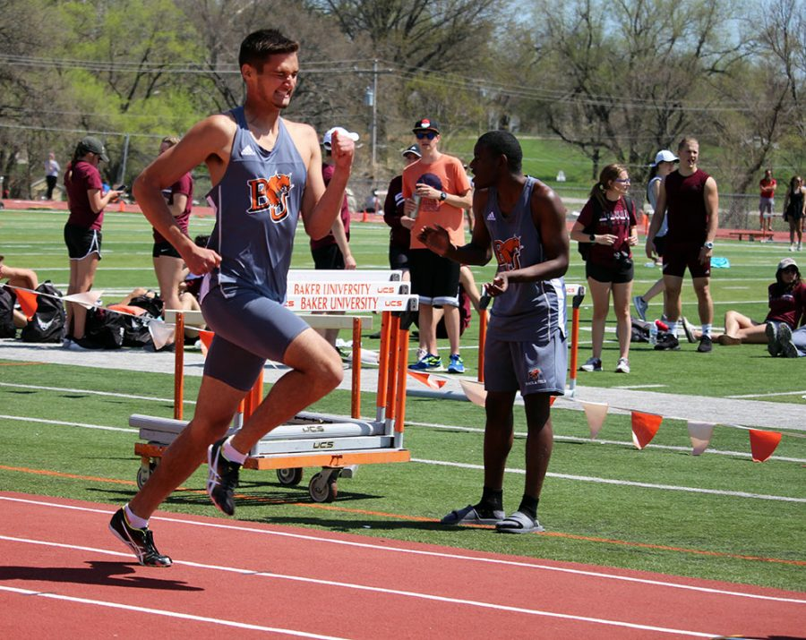 Wincing in pain to the finish, sophomore Danny Griese pushes down the straight away. Griese ran the 800 meter race in 2:01 at the Zach Kindler Wildcat Open. Griese was the first Wildcat to finish out of five.