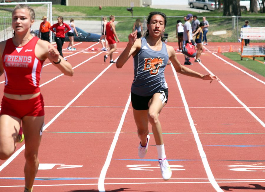 Sprawling for the finish, junior Gloria Mares finishes the 100 meter dash at the Zach Kindler Wildcat Open. Mares also competed in the women's 4x100m that qualified for the National Meet.