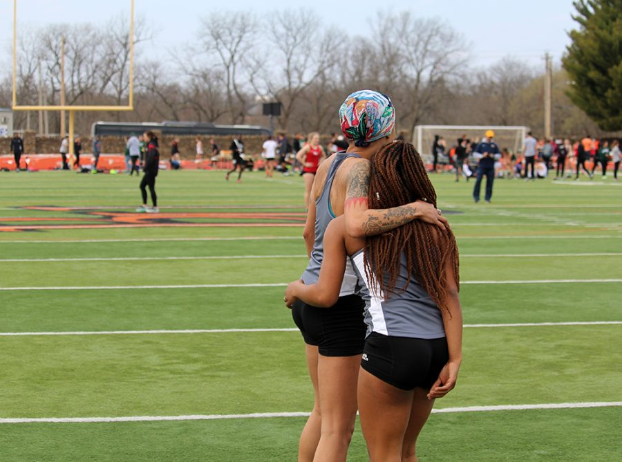 Taiylor Sharp and Myan Elrington embrace after their 4x100m race at the Baker Relays on March 31. The relay team finished second behind Grand View with a time of 50.09 seconds. Both the men's and women's track teams are in preparation to host The Heart conference meet on May 5.