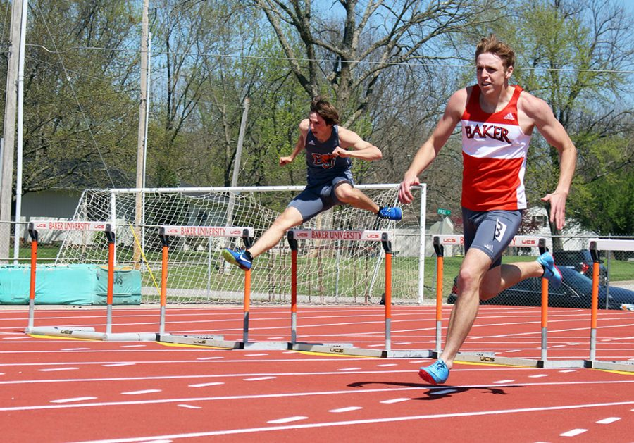 Benton McCann (left) and Michael Riddle (right) prepare for the final straight away of the 400 meter hurdles at the Zach Kindler Wildcat Open on April 28. McCann won the event followed by Riddle in second.