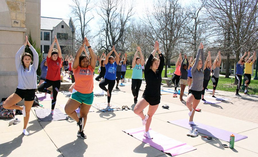 Students execute the tree pose while looking to Barbour for guidance. The event was hosted at 11 a.m. because there are no classes scheduled at this time on Tuesday's.