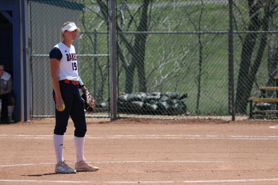 Olivia Brees waits for a sign from her coach before pitching. Brees would get the win against Clarke University.