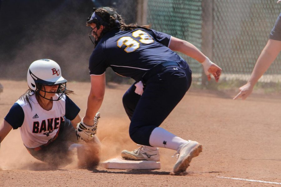 Freshman Briele Rees slides around a tag at third base in the wildcats matchup against Clarke University.