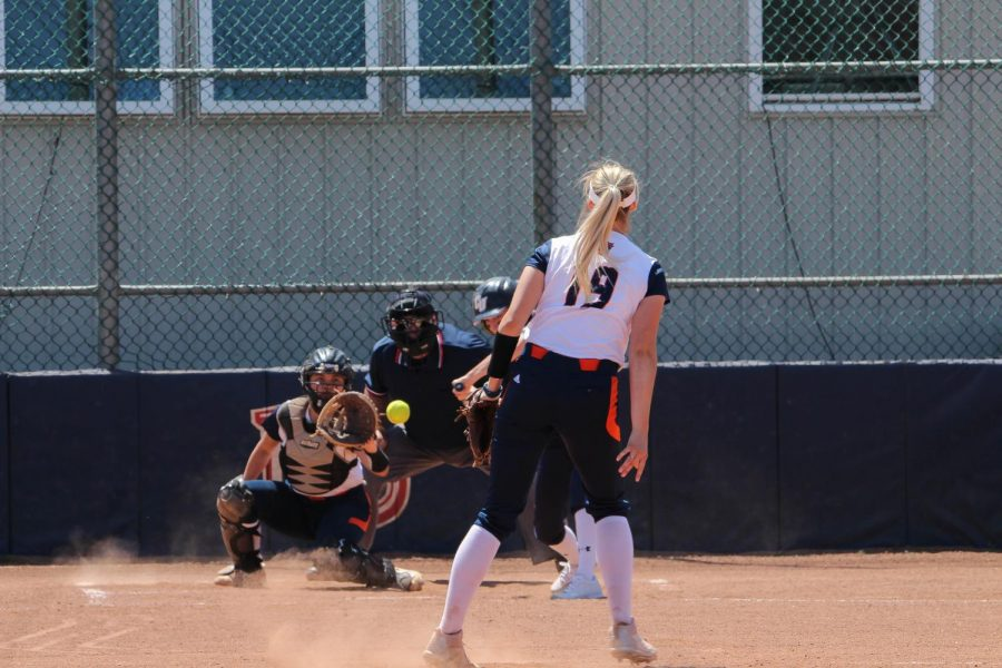 Junior Olivia Brees dilervers a pitch against Clarke University. The Wildcats would go on to sweep Clarke in its series at Cavaness Field.
