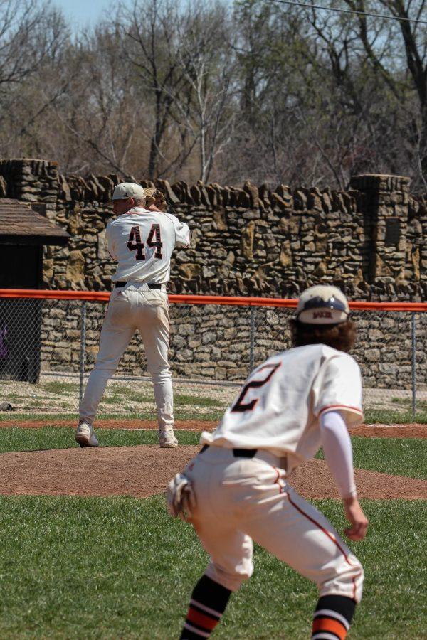 Senior Pitcher Bennett White checks on a runner as first baseman Brian Wircenske holds him on