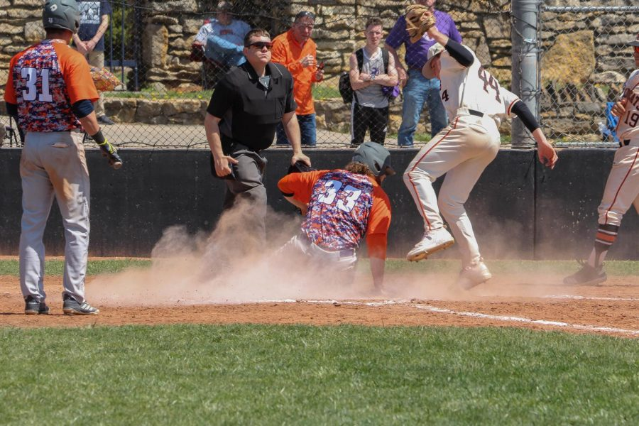 Pitcher Bennett White avoids contact as he tags a runner out at home