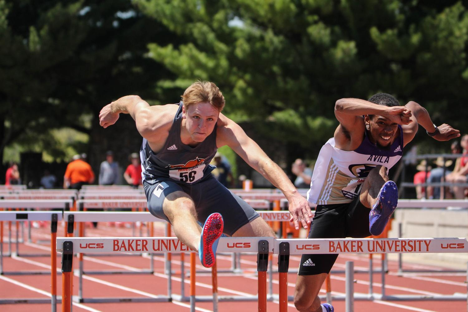 Senior+Michael+Riddle+extends+his+leg+over+a+hurdle+in+the+110+meter+hurdles+at+the+Heart+meet.+Riddle+claimed+seventh+place+in+the+110+meter+hurdles+and+and+fourth+in+the+400+meter+hurdles+later+the+same+day.