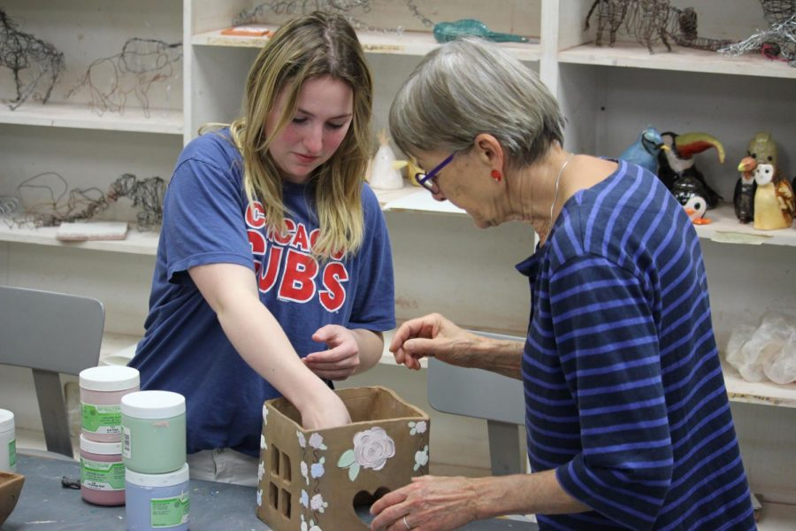 Sophomore+Erynne+Jamison+works+on+her+ceramic+birdhouse+with+the+assistance+of+Professor+Inge+Balch.Balch+spends+several+hours+a+day+in+the+Bennett+Art+building+teaching+and+firing+students+pieces