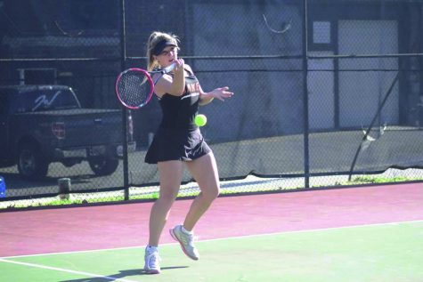 Freshman Janie King hits a forehand back to her Missouri Valley opponent in Baker's last home match of the season. The team fell to MVC 7-2.